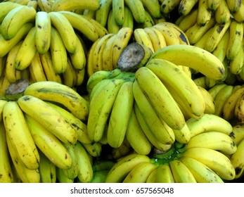 Fresh banana yellow background in the fruit market.