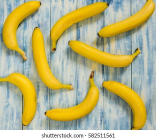Fresh bananas on a blue wooden background as a pattern