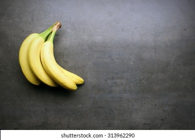 Fresh bananas on kitchen table with copyspace