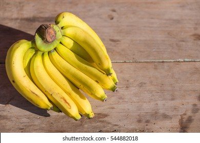Fresh bananas on wooden background - Bananas on a wooden picnic