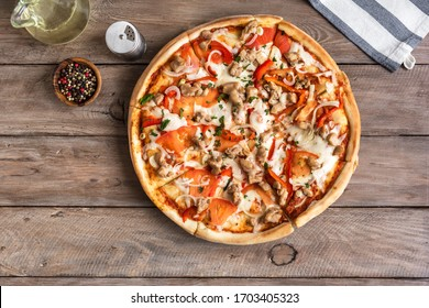 Fresh Barbecue Chicken Pizza with Vegetables and Mozzarella Cheese on wooden, top view, copy space. BBQ Pizza with chicken pieces.
