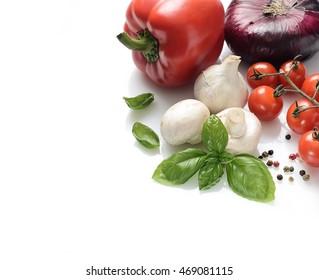 fresh basil, mushrooms, garlic and cherry tomatoes on a white background