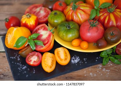 fresh basil and tomatoes on table