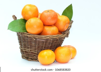 Fresh basket mandarins on white background