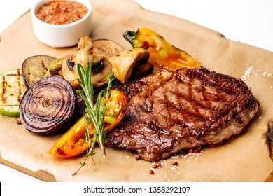 Fresh bbq meat on wooden plate with sauce, potato and onion. Menu concept