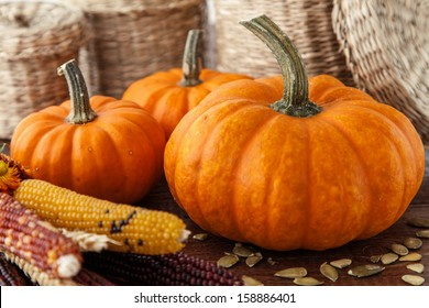 Fresh beautiful pumpkins on a wooden table