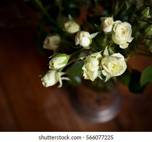 Fresh beautiful white little roses with water drops