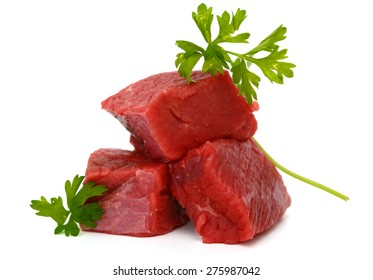 fresh beef cubes with parsley isolated on white