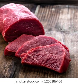 Fresh beef steak sliced on a background