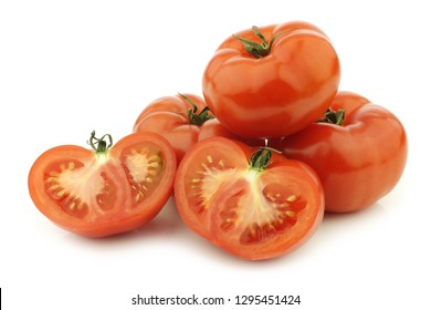 fresh beef tomatoes and a cut one on a white background
