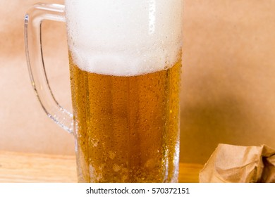 fresh beer with bread toast on wood