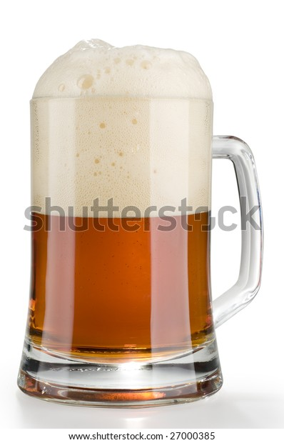 Fresh beer in a glass mug with froth isolated over white background