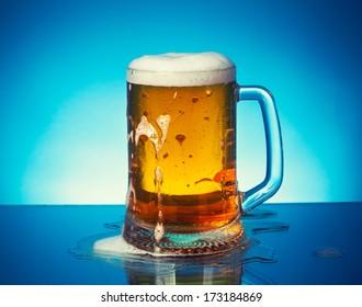 fresh beer on blue background