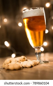fresh beer and peanuts on wood restaurant table indoor with cosy dim light