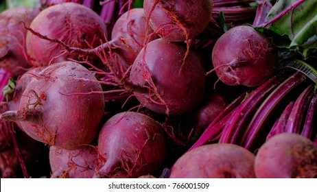 Fresh beets and beet tops  lie on farmer market counter.farmer's market