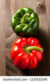 Fresh bell pepper isolated on wooden cutting board