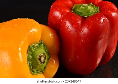 Fresh bell peppers on a black background