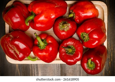 Fresh bell pepper,sweet pepper or capsicum on wooden plate and black wooden background