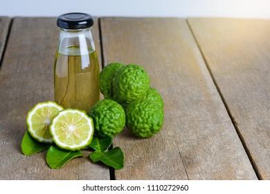 fresh bergamot fruit with Citrus bergamia and Bergamot essential oil on wooden table background