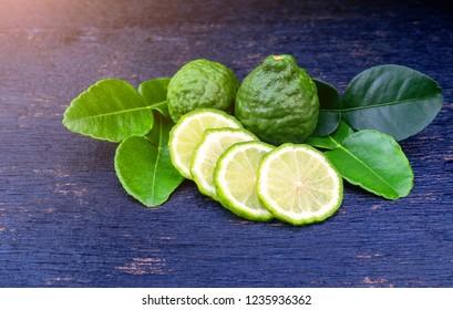 Fresh bergamot fruit and green leaf on blue wooden table background