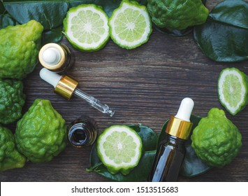 fresh bergamot fruit, Kaffir Lime, Citrus bergamia with leaf on wooden table. Bergamot citrus fruit essential oil or virgin cold pressed oil natural.organic cosmetic concept