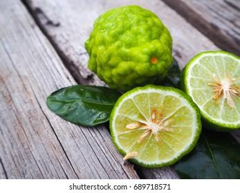 fresh bergamot fruit and bergamot slice on wooden background.