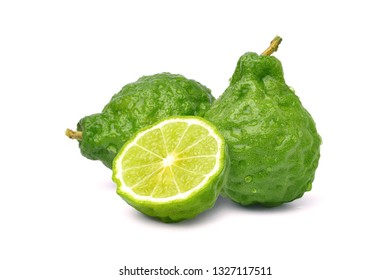Fresh Bergamot fruits with cut in half isolated on white background with clipping path.