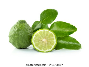 Fresh Bergamot fruits cut in half with leaves isolated on white background