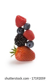 Fresh berries balanced on top of each other