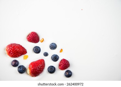 fresh berries fruits isolated on greek yogurt, healthy background