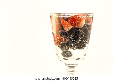 Fresh Berries in a Glass of Bubbly Water
