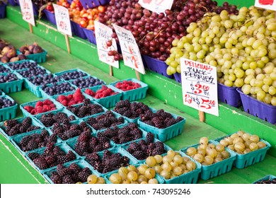 Fresh berries and grapes for sale at a farmer's market