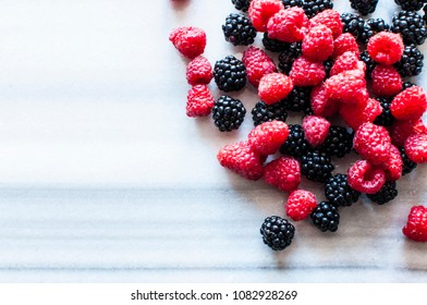 Fresh berries on marble table, selective focus