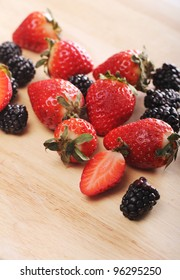 Fresh berries on wooden board with white background