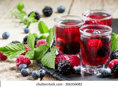 Fresh berry drink with blueberries, blackberries and raspberries, selective focus