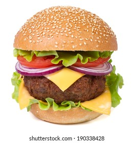 Fresh big hamburger with meat, cheese, tomatoes, onions and lettuce close-up isolated on white background