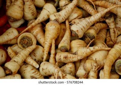 a lot of fresh and Bio  Parsnips in the box at the morning market. Health benefits of parsnips.