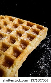 Fresh biscuit waffles on a black background