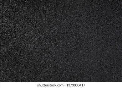Fresh black asphalt on road detail