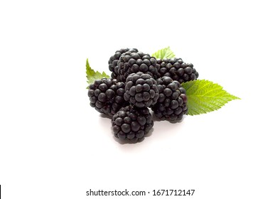 Fresh blackberry with green leaves isolated on white background. Top view. Flat lay pattern. Ripe blackberry fruits with leaves. Closeup shot of fresh berries.