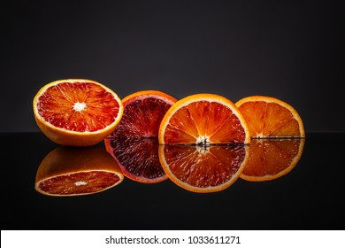 Fresh blood orange on clipping path black background