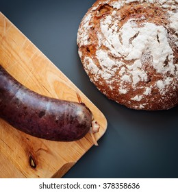 Fresh blood sausage and bread on a table