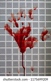 Fresh bloody handprint or bloodstains with streaks on wet bathroom tiles wall. Horror halloween or Violent Crime or Homicide murder or Domestic violence concept.