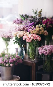 Fresh blossoming flowers at at the florist shop (roses, ranunculus, tulips, carnations)