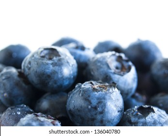 Fresh bluberries from local market on white background. Blueberries contain anthocyanins,  and various phytochemicals, which possibly have a role in reducing risks of some diseases.