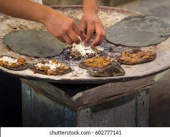 Fresh blue corn tortillas on the comale at the Xochimilco Market, Oaxaca