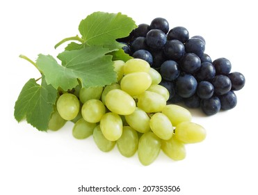 Fresh blue and green grapes with leaves. Isolated on white