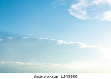 Fresh blue sky puffy white clouds background at dusk