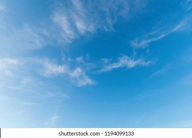 Fresh blue sky puffy white clouds background