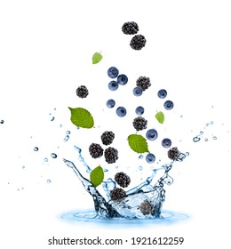 Fresh blueberries and blackberries with mint leaves flying falling in splashing water isolated on white background